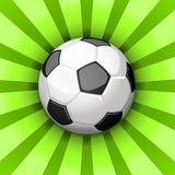 Soccer ball. Glossy soccer ball over green rays royalty free illustration