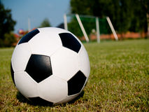 Soccer ball. Photo of football against the gate, made during a break in training the youth team Royalty Free Stock Photo