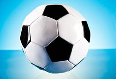 Soccer ball. And on the blue background Stock Photos