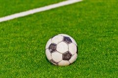 Soccer ball. On a football field Royalty Free Stock Photos