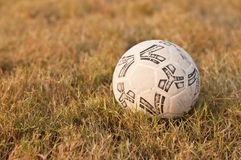 Soccer ball. On grass, at school Royalty Free Stock Photo