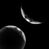 Soccer ball. On grass against black background Stock Images