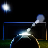 Soccer ball. On grass against black background Stock Photography