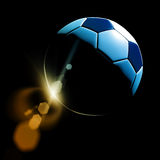 Soccer ball. On grass against black background Royalty Free Stock Image
