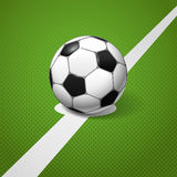 Soccer ball. Lying on the center of the game field Royalty Free Illustration