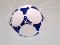 Soccer Ball. Splashing in to water Royalty Free Stock Photo