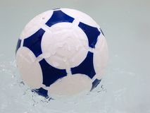 Soccer Ball. Splashing in to water Royalty Free Stock Images