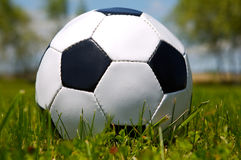 Soccer ball. Photo of a Soccer ball upon the green grass Royalty Free Stock Photo