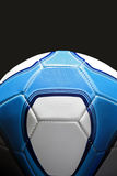 Soccer Ball. In Blue and white, shot on a black background with stylised rim lighting. The pattern is not affiliated to any team. This is not a club ball royalty free stock photo