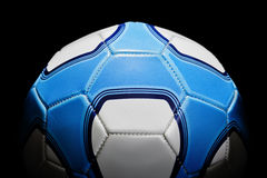 Soccer Ball. In Blue and white, shot on a black background with stylised rim lighting. The pattern is not affiliated to any team. This is not a club ball stock photo