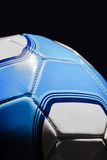 Soccer Ball. In Blue and white, shot on a black background with stylised rim lighting. The pattern is not affiliated to any team. This is not a club ball stock images