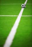 Soccer ball. On green grass Stock Photos