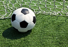 Soccer ball. On the field in the grid Stock Photography