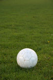 Soccer ball. And grass. Image with copyspace Royalty Free Stock Photos