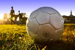 Soccer ball. On the grass with people Royalty Free Stock Photo
