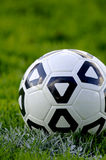 Soccer Ball. White and black soccer ball in field of green grass Stock Photos