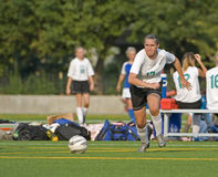 Soccer After the ball. High School girls varsity player going after the ball Royalty Free Stock Images
