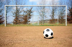 Soccer ball. A soccer ball on a soccer field. A goal in the background Royalty Free Stock Photo
