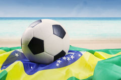 Soccer ball above brazilian flag Royalty Free Stock Images