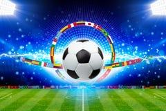 Soccer ball above green stadium with bright spotlights, main spo stock photography