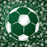 Soccer ball on abstract green background Royalty Free Stock Photos