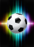 Soccer Ball on Abstract Spectrum Background Stock Images