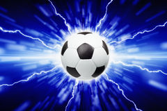 Soccer ball. Abstract sports background - soccer ball, bright lights and lightnings Stock Image