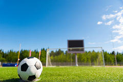 Soccer ball agains goal. Royalty Free Stock Images