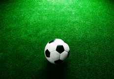 Soccer ball against artificial turf. Studio shot. Copy space. Stock Image