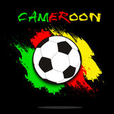 Soccer ball against the background of the Cameroon flag Royalty Free Stock Photo
