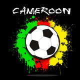 Soccer ball against the background of the Cameroon flag Royalty Free Stock Photos