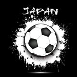 Soccer ball and Japan flag. Soccer ball against the background of the Japan flag of paint blots. Vector illustration Royalty Free Illustration