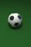 Soccer ball against green Stock Photo