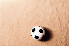 Soccer ball against sandy beach. Studio shot. Copy space. Stock Image