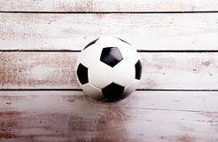 Soccer ball against wooden background. Studio shot. Copy space. Stock Images