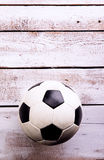 Soccer ball against wooden background. Studio shot. Copy space. Stock Photos