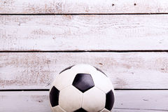 Soccer ball against wooden background. Studio shot. Copy space. Royalty Free Stock Images