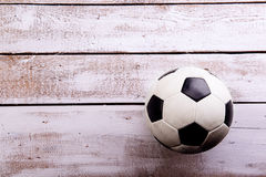 Soccer ball against wooden background. Studio shot. Copy space. Stock Photography