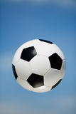 Soccer ball in the air Royalty Free Stock Images