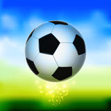 Soccer ball in the air. With abstract green background Royalty Free Stock Photo