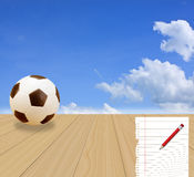 Soccer Ball andon wood floor with a blue sky Stock Photo