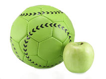 Soccer ball and apple Royalty Free Stock Image