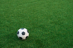 Soccer ball on artificial turf Royalty Free Stock Image