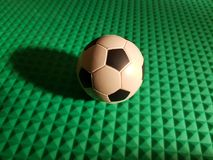 Soccer ball as the center of everything, on green 3d texture Stock Photography