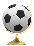 Soccer ball as terrestrial globe on golden stand Royalty Free Stock Images