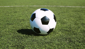 Soccer ball on astro turf Stock Images