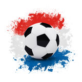 Soccer ball on the background of beautiful blots Royalty Free Stock Images