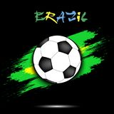 Soccer ball and Brazil flag. Soccer ball on the background of the Brazil flag in grunge style. Vector illustration Royalty Free Stock Photo