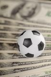 Soccer ball on background of dollars Royalty Free Stock Photo