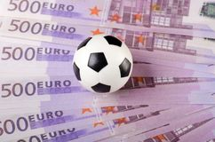 Soccer ball on background of euro Stock Images